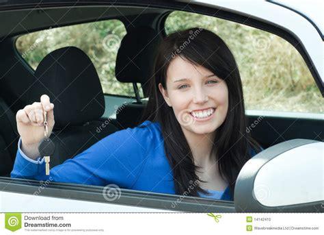 Jolly Teen Girl Sitting In Her Car Holding Keys Stock