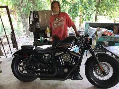 Old Man Dressed In Shabby Clothes Buys Harley-davidson