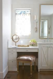pretty bathroom with a mauve velvet vanity stool tucked below a built in ivory dressing