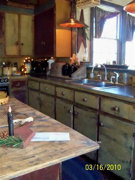 how to decorate kitchen cabinets 20 best primitive tables images on primitive 7226