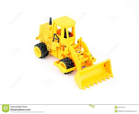 old yellow old yellow tractor toy on white background royalty free