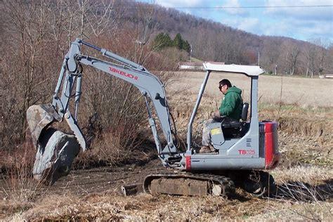 takeuchi tb mini excavator  thumb picks   big rock ht