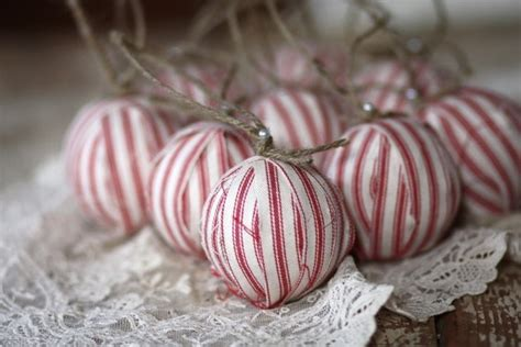 fabric wrapped styrafoam balls with twine as ornaments