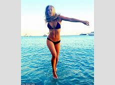 Bar Refaeli shows off her supermodel curves in a TINY