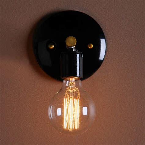 wall light bulb minimalist wall light by unique s co notonthehighstreet com