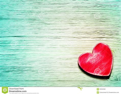 decorative red heart  blue wooden background stock photo