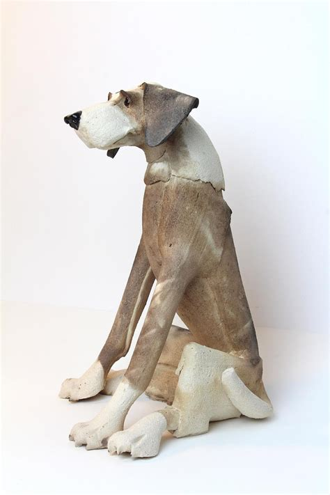sitting patchy dog ceramic sculpture  virginia dowe