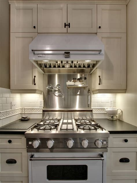 white viking range  hood transitional kitchen