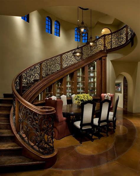 curved staircase wraps  mediterranean dining room hgtv