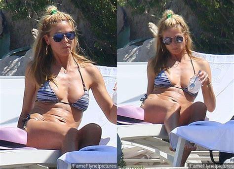 Heidi Klum Shows Off Amazing Bikini Body While Tanning in France