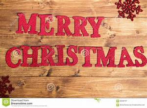words merry christmas made from red glittering letters With large wooden christmas letters