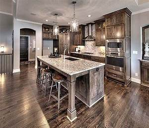 Open Kitchen With Large Granite Island, Beautiful Lighting