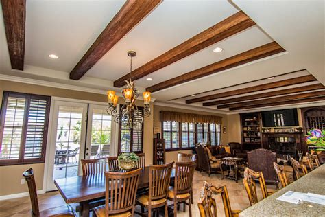 Wood Beams  Faux Wood Beams. Center Island Kitchen. Painting A Brick House. Cool End Tables. Oklahoma Home Builders. Stacked Stone Fireplace. Taupe Rug. Mid Century Media Stand. Jewelry Tree Stand