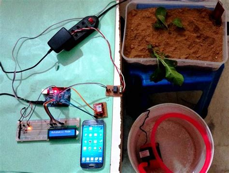 arduino based automatic plant irrigation project  sms