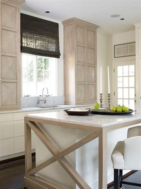 chic cottage kitchen features light wood cabinets