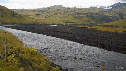 River Flowing Through Valley Mountain Range