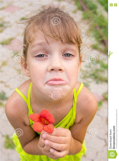 Funny Girl With Flower Her Hand Crouched Begging