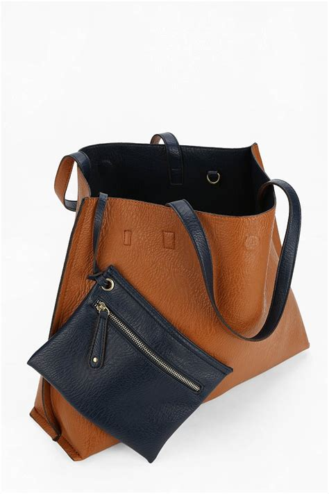 urban outfitters reversible vegan leather tote bag  blue