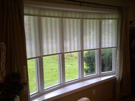 close fitting shades   bow window  draperies