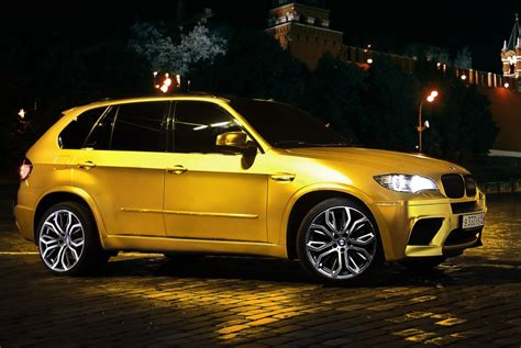 bmw   wrapped  gold autoevolution
