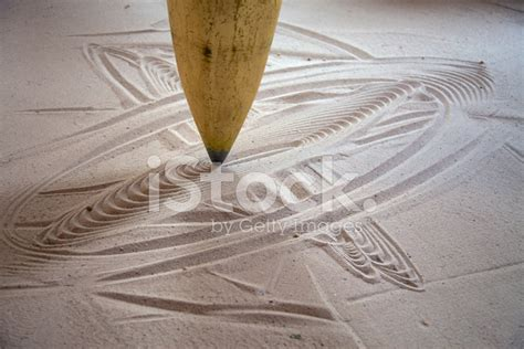 Close Up Of A Pendulum Movement In Sand Stock Photos