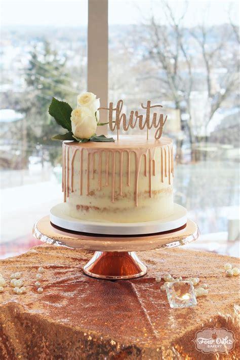 rose gold semi naked drip cake  oaks bakery
