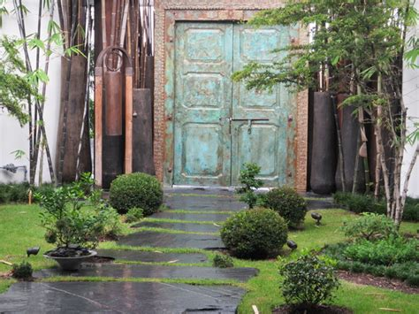 front entrance stepping walkway with rustic front door asian landscape miami by