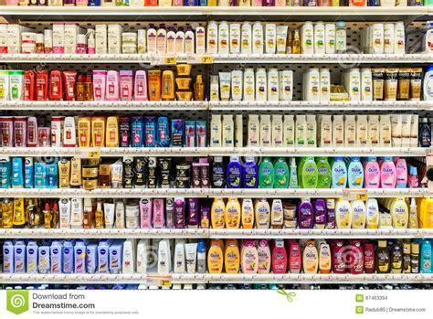 shampoo bottles  sale  supermarket stand editorial