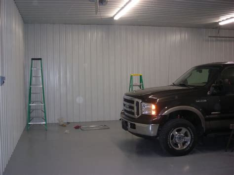 cheap garage wall covering materials for garage ceiling metal vs 4x8 panels the