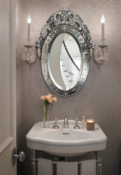 Gray French Powder Room With Oval Venetian Mirror French