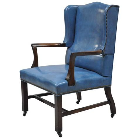 mid 20th century blue leather office desk chair on casters