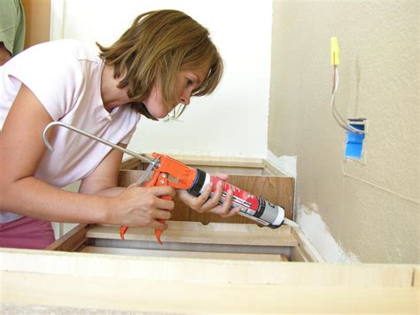 what kind of caulk for kitchen sink how to install a bathroom countertop how tos diy