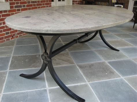 crafted forged table base with granite top by