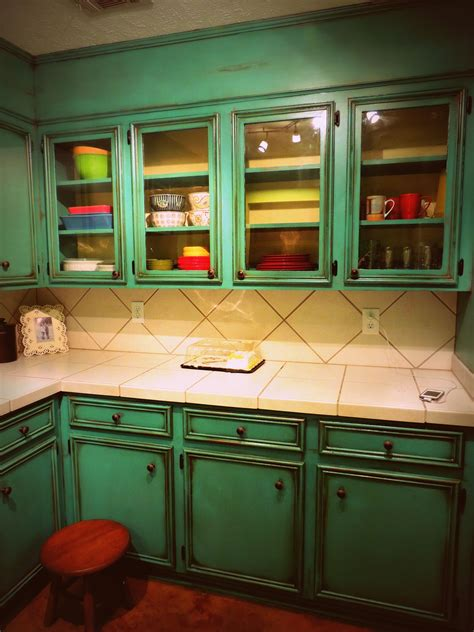 showing   antiqued turquoise cabinets