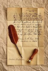 old letter with vintage feather quill stock photo With vintage letters