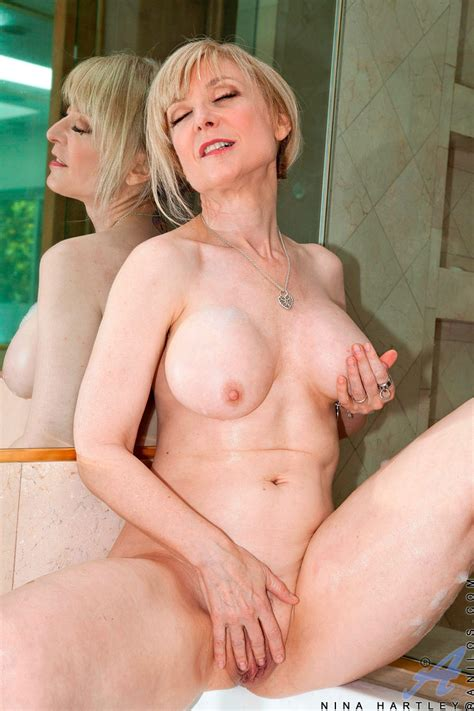 seductive cougar nina hartley stuffs her wet pussy with a glass toy granny seduction