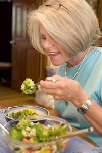 Who Designs Buildings Salad Free Stock Photo A Woman Eating A Fresh Salad