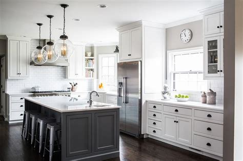 white cabinets  charcoal gray kitchen island