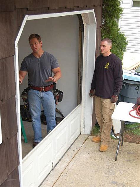 Putting A Door Into A Garage by How To Install A Garage Door How Tos Diy