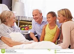Family Visit To Grandmother In Hospital Bed Stock Photo ...