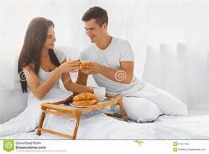 Couple Having Breakfast In Bed Stock Photo - Image: 61077784