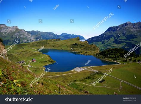 Valley With Lake Between Mountains In Swiss Alps Stock