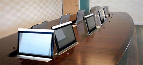 custom conference table hides impressive av system