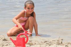 girl digging   beach stock photo