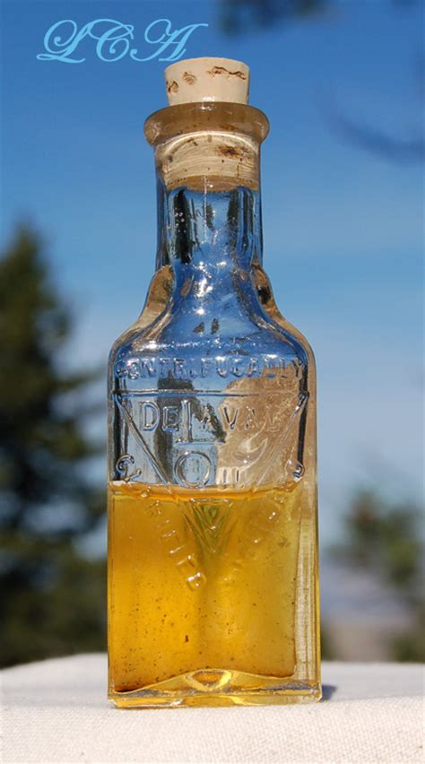 antique delaval oil bottle w orig label for cream