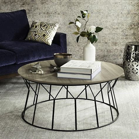 The urban styling is focused on modern simplicity and street style decoration. Lowest Price Safavieh Deion Retro Mid Century Wood Coffee Table, Light Grey / Black