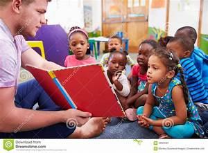 Volunteer Teacher Reading To A Class Of Preschool Kids ...