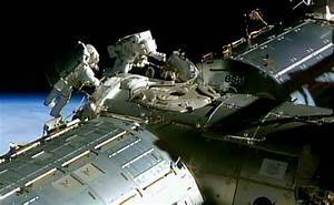 US Astronauts Begin Spacewalk to Lay Cable at ...