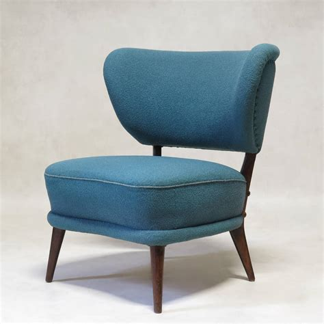 pair of mid century modern wingback slipper chairs for
