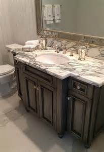 gray wash vanity with gray and white marble countertop